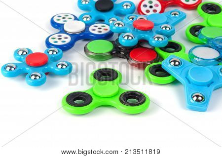 Various colored fidget spinners - stress relieving toys on a white background