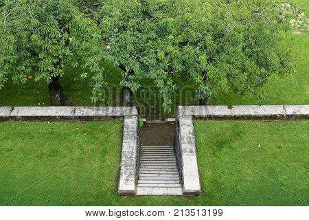 formal garden design old stone stair in the lawn leads down to the orchard areal view from above copy space