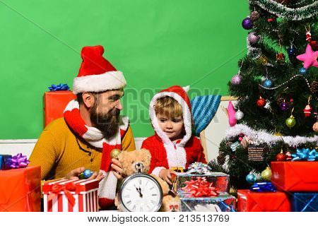 Santa Claus And Little Assistant Child In Christmas Room