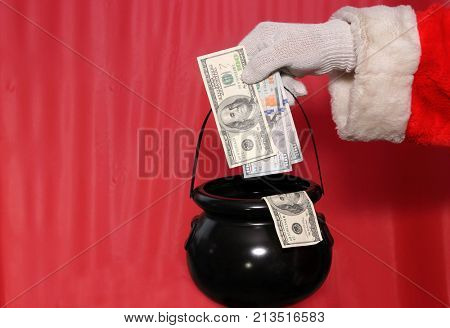 Santa Claus Donation Bucket. Christmas Donation Bucket filled with cash.