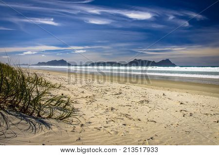 White Sandy Beach With Beautiful Blue Sky At Waipu,new Zealand