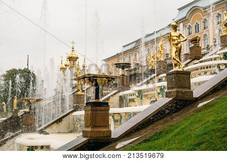 Saint Petersburg, Russia - Circa June 2017: Grand cascade in Pertergof or Peterhof in St. Petersburg, known as Petrodvorets from 1944 to 1997. Famous tourist place with golden statues