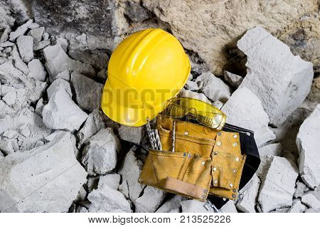 Demolition Of Walls. Electric Hammer Helmet And Hearing Protection Lying On The Rubble. Old Brick An