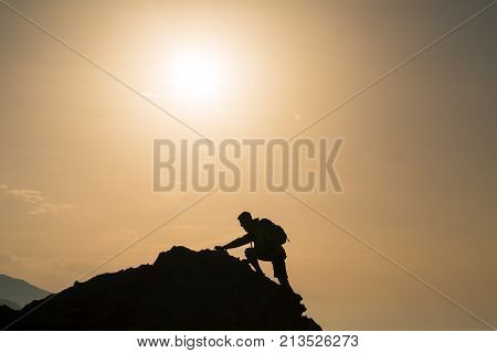 Climbing Hiking Silhouette In Mountains Over Summer Sunrise