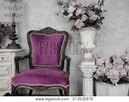 vintage chair in antique room decoration with old ancient furniture. vintage classic style interior background for wallpaper. picture is painted in pale colors and highlight on purple vintage chair.