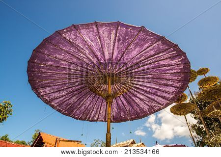 Giant purple umbrella in the north of Thailand tradition