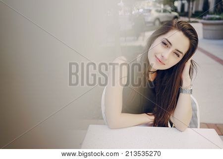 young girl in a cafe waiting for your order in caffe