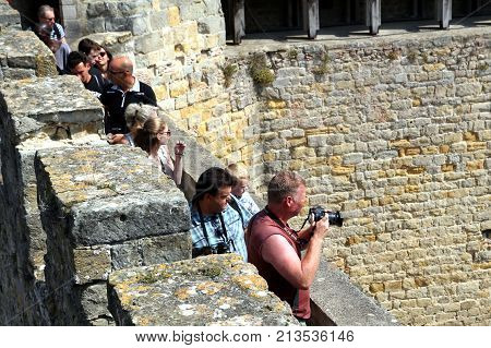 Carcassonne, Languedoc-roussillon, France - August 24 2017: Visitors On The Battlements Tour At The