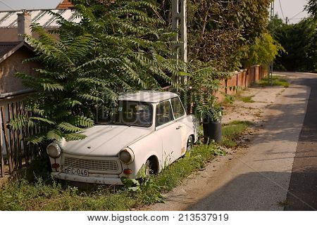 DIOSD, HUNGARY - SEPTEMBER 15, 2017: Old weathered Trabant on the street. Trabant was a popular cheap, small car in the communist countries of Eastern-Europe. Made in East-Germany.