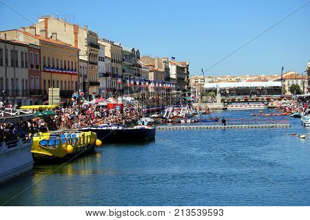 Sete, Herault, France  - Aug 21 2017: Crowds Gather Around The Banks Of The Royal Canal Ready For Th