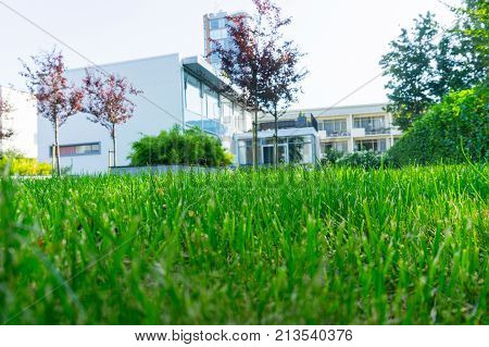 ROTTERDAM HOLLAND- AUGUST 23 2017; Green lawn in selective focus leading to historic 1930's residence known as Sonneveldt House preserved in it original art deco style as a museum