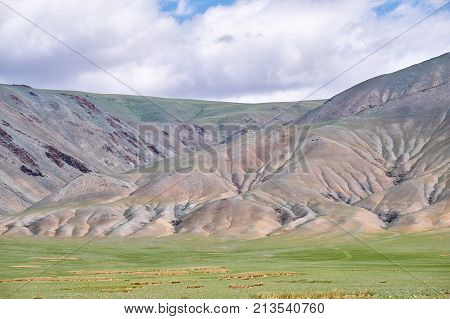 Mongolian Mountain Natural Landscapes With Eroded Foothill Slopes Near Lake Tolbo-nuur In North Mong