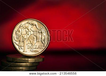 Australian money over vibrant red background.