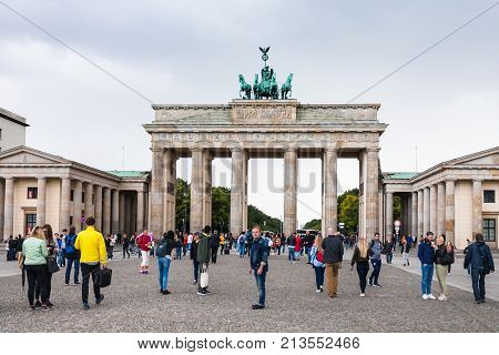 People Near Brandenburg Gate In Berlin In Autumn