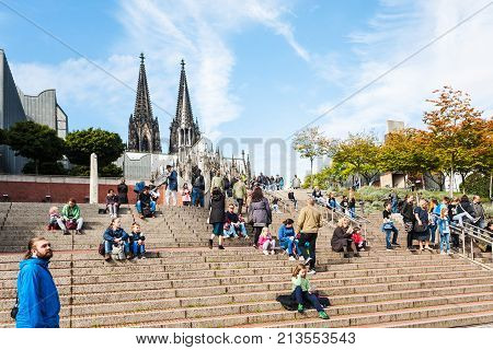 Tourists On Steps In Cologne City In September