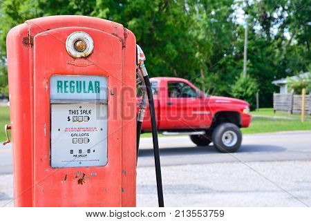 Cuba, Missouri, Usa - July 18, 2017: Old rusty american gas pump in Cuba, Missouri. Displaying the price in dollars and filling amount in gallons.