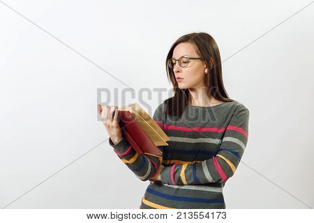 Beautiful European Young Brown-haired Woman In Glasses For Sight Dressed In Casual Dark Grey Longsle
