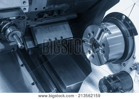 The CNC lathe or turning machine with the milling spindle . The turn-mill machine Hi-precision CNC machining concept.