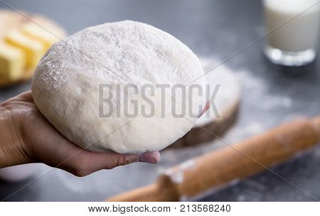 woman hands working with dough preparation recipe bread, pizza or pie making ingridients