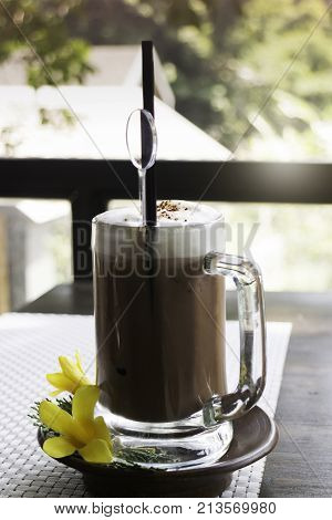 Iced coffee latte on balcony wooden table stock photo