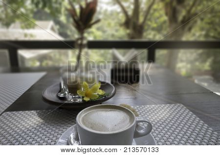 Hot coffee latte on balcony wooden table stock photo
