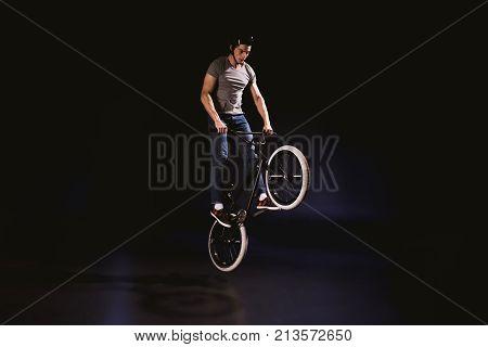 Bmx Cyclist Performing Stunt