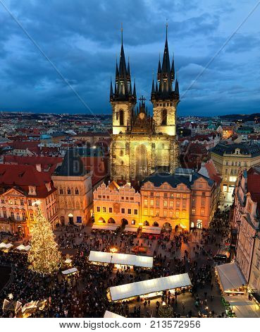 PRAGUE, CZECH REPUBLIC - DECEMBER 11, 2016: View from above on famous traditional Christmas market and Tyn church at Old Town Square illuminated and decorated for winter holidays in Prague.