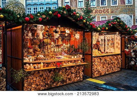 PRAGUE, CZECH REPUBLIC - DECEMBER 11, 2016: Wooden kiosks with souvenirs and decorations during Christmas market in Prague - very popular destination with locals and tourists visiting the city.
