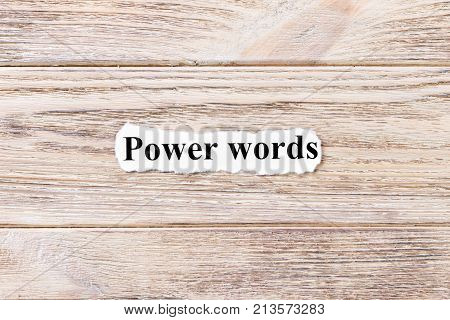 power of words of the word on paper. concept. Words of power of words on a wooden background.