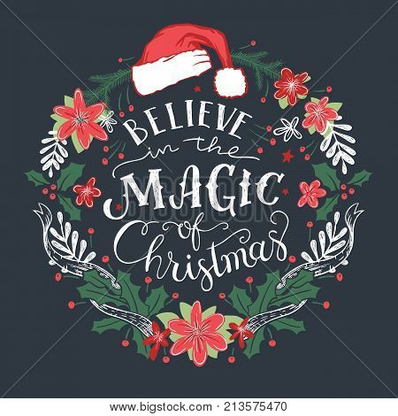 Believe in the Magic of Christmas. Decorative wreath with hand drawn typography and Santa Claus hat
