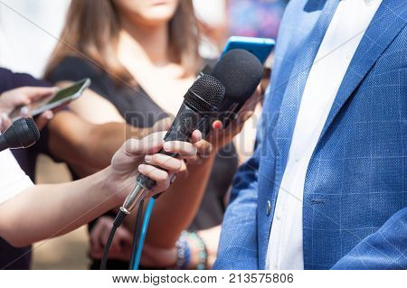 Media or press interview with business person or politician