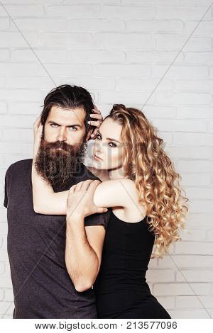 Man With Beard And Woman With Long Blond Hair