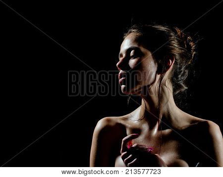 Girl with oily or wet skin on black background. Beauty fashion look. Purity perfection sensuality concept. Woman with sensual face and bare shoulders. Skincare moisture wellness copy space