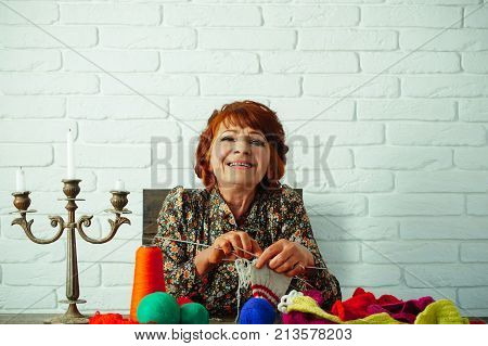 Happy Old Lady Or Grandmother With Needle And Yarn.