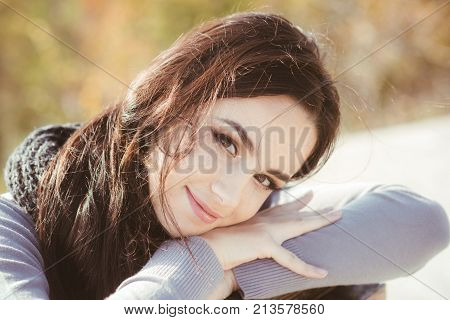 Woman With Long Brunette Hair On Autumn Nature