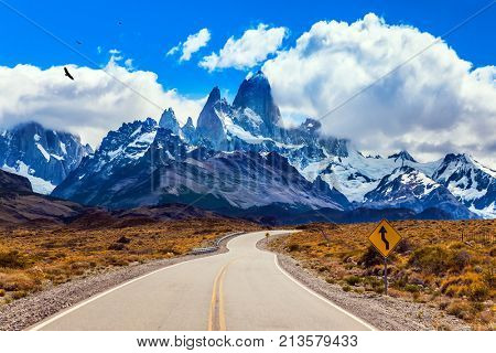 Fine highway to the grandiose Mount Fitz Roy. Summer day in Patagonia. The concept of active and extreme tourism. The Andean condors hover over the prairie