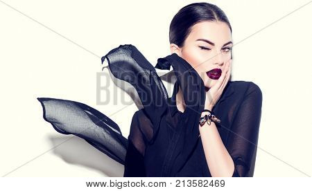 Beauty Fashion model girl with dark lips portrait, wearing stylish chiffon dress. Sexy woman portrait with perfect makeup and manicure, trendy accessories and fashion wear. Beauty trends