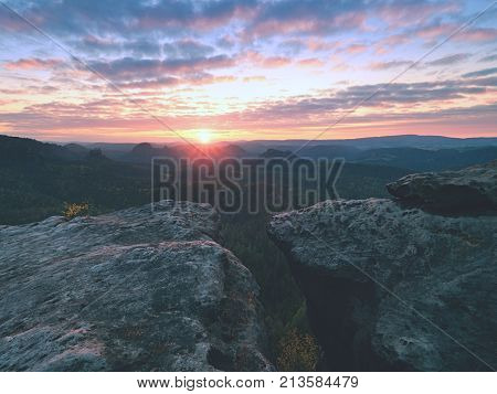 Exposed Sandstone Cliff Above Deep Misty Valley At The End Of Summer. Dreamy Mood