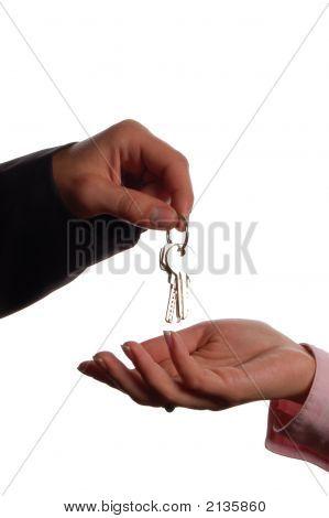 Man Handing A Women A Set Of Keys