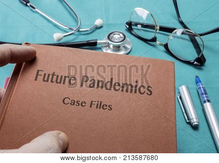 Doctor Holds Book On future pandemics In A Hospital