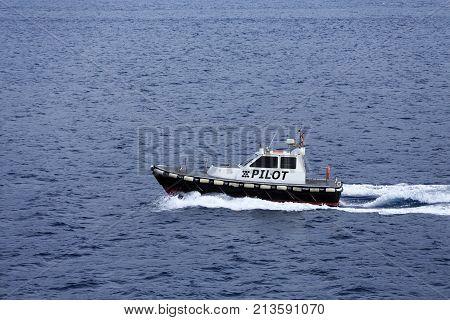 An Italian Pilot boat navigating the strait of Messina