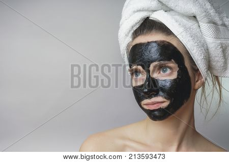 Black mask on woman face,smiling,skincare,cleansing pore,against acne