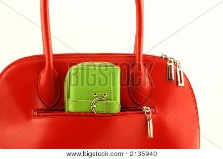 Green Wallet In Red Handbag'S Pocket