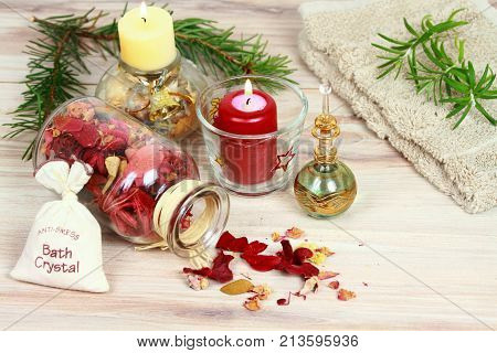 Aromatherapy spa concept with candles. Aromatherapy treatment aromatic herbs oil bath crystals on wooden background