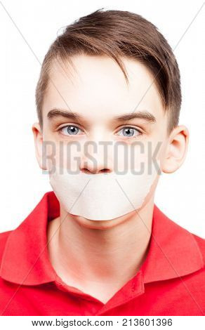 Portrait of teenager boy with adhesive tape on his mouth - silenced child concept