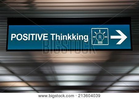 think positive concept. sign positive thinking with lightbulb icon and arrow for direction.