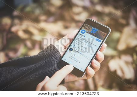 CHIANG MAI THAILAND - NOV 10 2017: Woman holding a brand new Apple iPhone 6s with Twitter logo on the screen. Twitter is a social media online service for microblogging and networking communication.