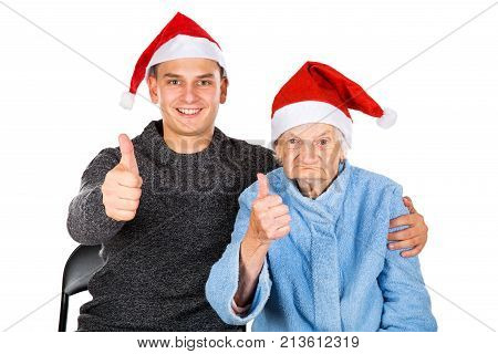 Picture of an old lady celebrating Christmas with her grandson