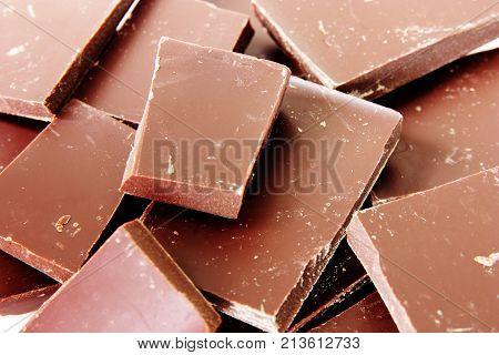 sweet chocolate pieces close up . selective focus