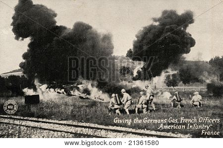 FRANCE - CIRCA 1900: Giving Germans Gas -  Early 1900 postcard depicting French Officers & American infantry gassing Germans in France during WWI circa 1900.